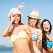 Stock Photo: Girls in bikini with ice cream on the beach