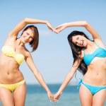 Girls having fun on the beach — Stock Photo #29060419