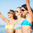 Girls in bikini walking on the beach — Stock Photo