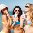 Girls in bikini with ice cream on the beach — Stock Photo