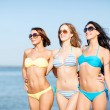 Girls in bikini walking on the beach — Stock Photo #29060947