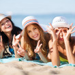 Girls sunbathing on the beach — Stock Photo #29060949