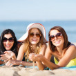 Girls sunbathing on the beach — Stock Photo #29061009