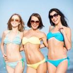 Girls in bikini walking on the beach — Stock Photo #29061353