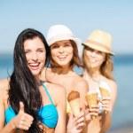 Girls in bikini with ice cream on the beach — Stock Photo #29063399