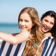 Stock Photo: Girls sunbathing on beach chairs