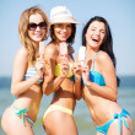Girls in bikini with ice cream on the beach — Stock Photo #29068637