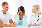 Doctor with patients in cabinet — Stock Photo