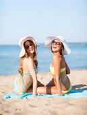 Girls sunbathing on the beach — Stock Photo