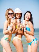 Girls in bikini with ice cream on the beach — Stock Photo