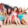 Girls with drinks on the beach — Stock Photo #29134031