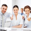 Business team showing thumbs up in office — Stock Photo #29134151