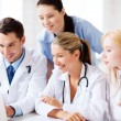 Group of doctors looking at tablet pc — Stock Photo #29134551