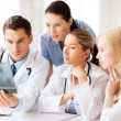 Group of doctors looking at x-ray — Stock Photo #29134573