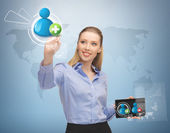 Woman with virtual screen and contacts — Stock Photo