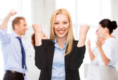 Businesswoman celebrating succes in office — Stock Photo