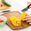 Woman hands cutting vegetables — Stock Photo #29246351