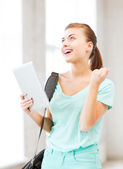 Happy student girl with tablet pc — Stock Photo