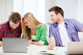 Students writing something at school — Stock Photo