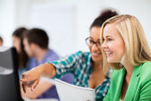 Students with computer studying at school — Stock Photo