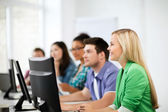Students with computers studying at school — Stock Photo