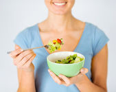 Woman eating salad with vegetables — Stock Photo