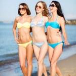 Girls in bikini walking on the beach — Stock Photo #29453967