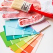 Paintbrush, gloves and pantone samplers — Stock Photo