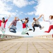 Group of teenagers jumping — Stock Photo #29455963