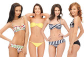 Group of model girls in bikinis — Stock Photo