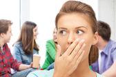 Terrified student girl at school — Stock Photo