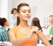 Student drawing checkmark on virtual screen — Stock Photo