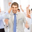 Happy businessman with cash money in office — Stock Photo