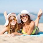 Girls sunbathing on the beach — Stock Photo #29513395