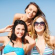Girls sunbathing on the beach chairs — Stock Photo