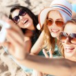 Girls making self portrait on the beach — Foto Stock