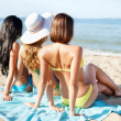 Stock Photo: Girls sunbathing on the beach