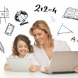 Girl and mother with tablet and laptop — Stock Photo