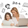 Girl and mother with tablet and laptop — Stockfoto