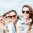Teenage girl with friends outside — Stock Photo