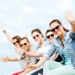 Group of teenagers waving hands — Foto de Stock