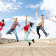 Group of teenagers jumping — Stock Photo #29558221