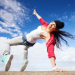 Beautiful dancing girl in movement — Stock Photo #29558417