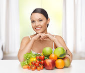 Woman with fresh fruits and vegetables — Stock Photo