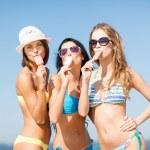 Girls in bikinis with ice cream on the beach — Stock Photo #29751319