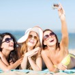 Girls taking self photo on the beach — Stock Photo #29751341