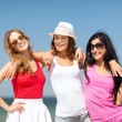 Stock Photo: Group of girls chilling on beach