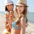 Girls in bikinis with ice cream on the beach — Stock Photo