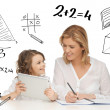 Girl and mother doing homework with tablet pc — Foto de Stock