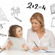 Girl and mother doing homework with tablet pc — Stockfoto